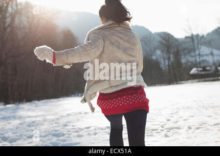 Woman running in snow - Stock Photo