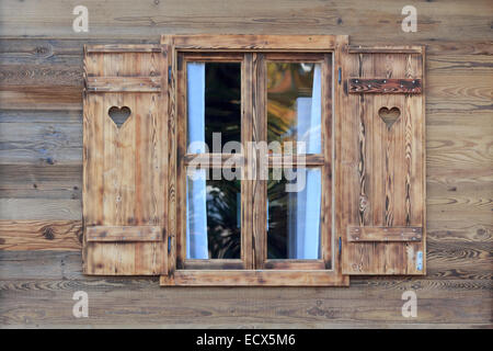 Wooden frame window in log cabin with basic curtains fort for Log cabin window treatments