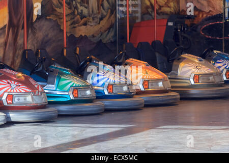 A set of parked bumper cars for autoscooter next to each other - Stock Photo