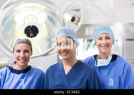 Portrait of three female surgeons in operating theater - Stock Photo