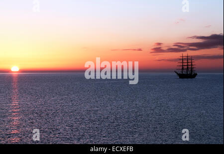 Georg Stage, a three-masted full-rigged Danish training tall ship at sunrise on the Sound in Denmark one spring - Stock Photo