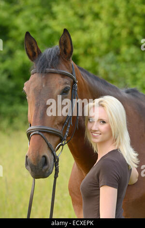 Young rider and her Bavarian horse - Stock Photo