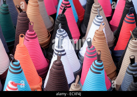 Lots of colourful zippers coiled into cone shaped spirals for sale on a market stall. France, Europe - Stock Photo