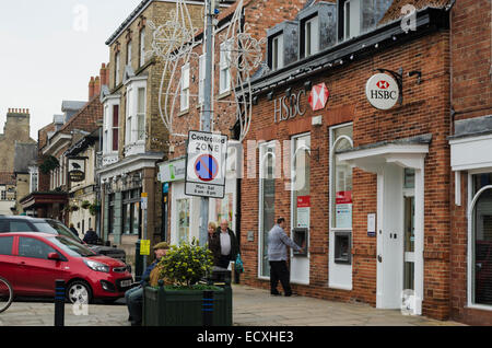 Street view in Pocklington, showing the HSBC bank and a controlled parking zone warning sign. - Stock Photo