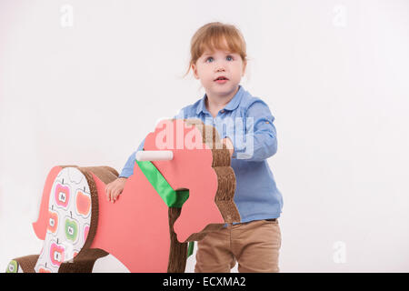 Child with the toy horse - Stock Photo