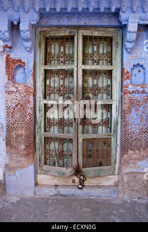 Old door of house in the Blue City, Jodhpur, Rajasthan, India - Stock Photo