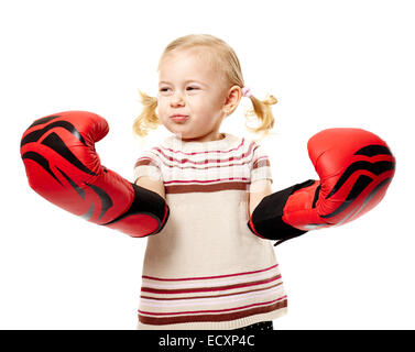 Little blond girl with huge boxing gloves, fighter spirit concept - Stock Photo