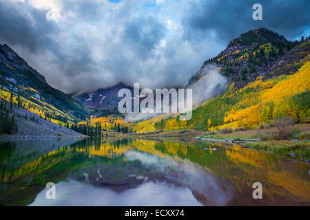 The Maroon Bells are two peaks in the Elk Mountains, Maroon Peak and North Maroon Peak, separated by about a third of a mile.