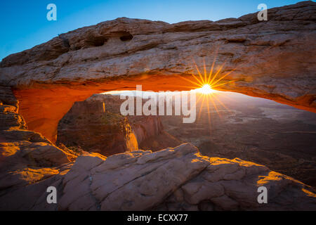 Mesa Arch at sunrise, Island in the Sky district of Canyonlands National Park, Utah - Stock Photo