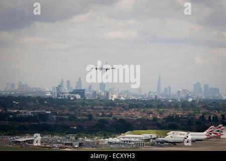 Aerial view (from control tower) of landing 747 jet and showing expanse of airport land at London Heathrow. - Stock Photo