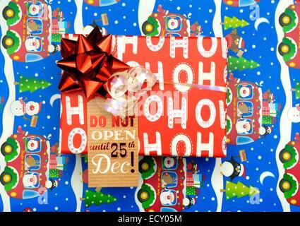 Ho Ho Ho christmas gift box with DO NOT OPEN UNTL 25TH DECEMBER - Stock Photo
