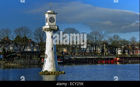 Panoramic view of Roath Park boat houses and restaurants, with the Scott memorial lighthouse in the foreground. - Stock Photo