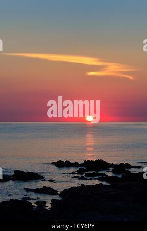 Sunset over the sea, San Teodoro, Province of Olbia-Tempio, Sardinia, Italy - Stock Photo
