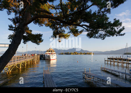 Pier in Gstadt and Fraueninsel island, Lake Chiemsee, Chiemgau, Upper Bavaria, Bavaria, Germany - Stock Photo