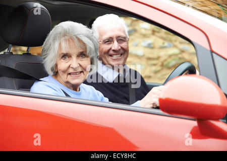 Portrait Of Smiling Senior Couple Out For Drive In Car - Stock Photo