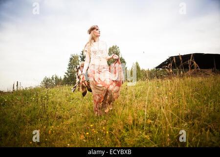 Caucasian woman walking in field