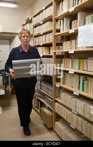 Old recording Sound Archives on tape and disk,  stored in Clitheroe Castle, Lancashire, UK. Ms Carole Enwistle facing - Stock Photo