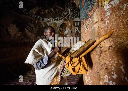 Priest in the Abuna Yemata rock-hewn church, Ethiopia - Stock Photo