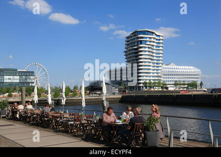 Cafe at Dalmannkai, view to Marco  Polo Tower and Unilever building, Hafencity, Hamburg, Germany, Europe - Stock Photo