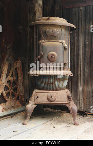 Old Pot Belly Stove. Name plate identification is Mity Oak. Rabbit Hash, Kentucky, USA. Circa 1813. A historic small - Stock Photo