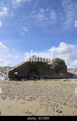 Damaged Atlantic wall bunkers and defences in Normandy, France on Gold Beach. - Stock Photo