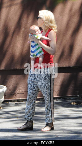 Gwen Stefani, wearing a red top and sunglasses, out and about in Los Angeles with her husband and two kids  Featuring: - Stock Photo