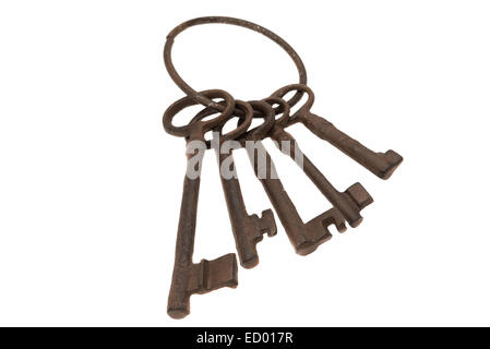 A set of old rusty antique keys - studio shot with a white background - Stock Photo