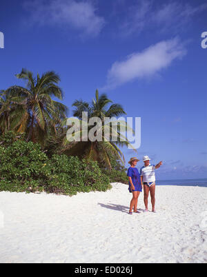 Older couple on beach, Île aux Cerfs Island, Flacq District, Republic of Mauritius - Stock Photo