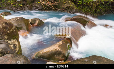 The cerulean blue waters of the Rio Celeste in Volcan Tenorio National Park, Costa Rica. - Stock Photo
