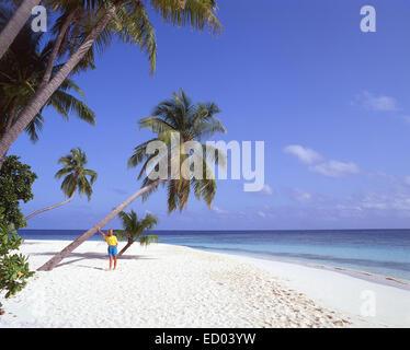 Young woman on tropical beach, Kuda Bandos Island, Kaafu Atoll, Republic of Maldives - Stock Photo