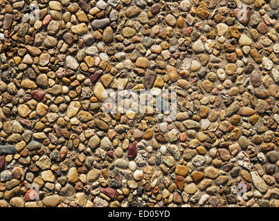 exposed aggregate concrete with rounded pebbles background texture - Stock Photo