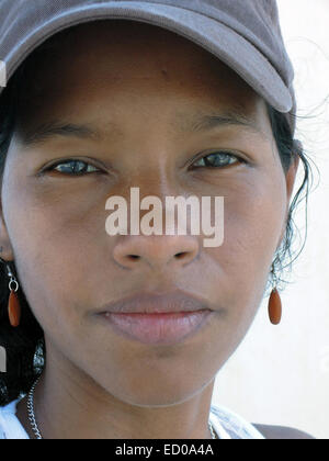 pretty young Creole Latina woman from Corn Island Nicaragua with serious look on face - Stock Photo