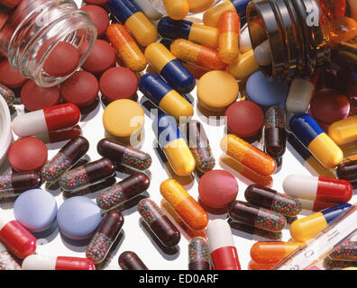 Assorted pills, capsules and tablets on glass background - Stock Photo
