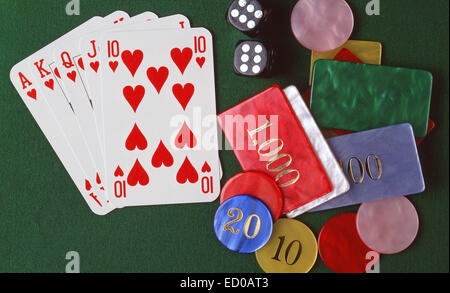Gambling table with cards, dice and chips. - Stock Photo