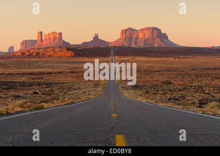 Straight road leading to Monument Valley, Utah, United States - Stock Photo