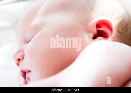 Close up of sleeping newborn (0-1 months) girl - Stock Photo