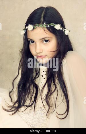 Little girl (6-7) portrait in white - Stock Photo