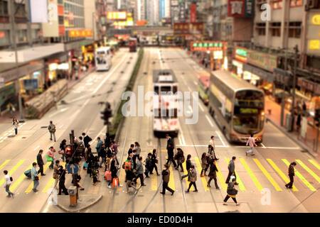 China, Causeway Bay, Hong Kong, People crossing pedestrian lane - Stock Photo