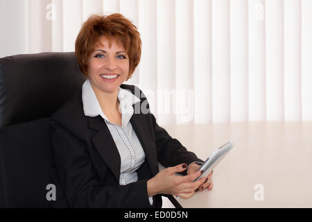 Bulgaria, Sofia, Portrait of business woman in office - Stock Photo