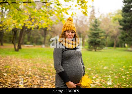 Bulgaria, Sofia, Pregnant woman in park - Stock Photo