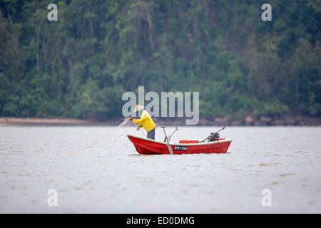 Malaysia, Sarawak state, Kuching, fisherman at the mouth of the river Salak in the South China Sea - Stock Photo