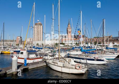 France, Nord, Dunkirk, boats in the marina and city hall belfry listed as World Heritage by UNESCO - Stock Photo