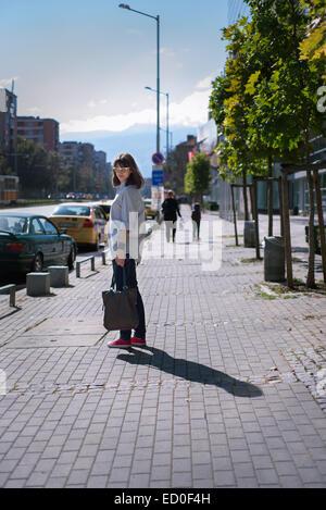 Bulgaria, Sofia, Woman in city - Stock Photo