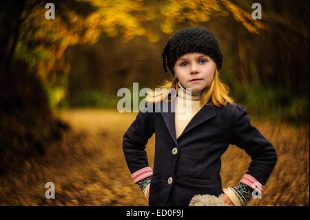 Portrait of little girl (2-3) posing on park