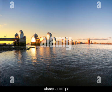 United Kingdom, England, London, Thames Barrier towers at sunset - Stock Photo