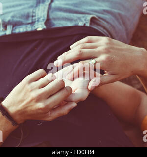 Close-up of woman touching a man's hand - Stock Photo