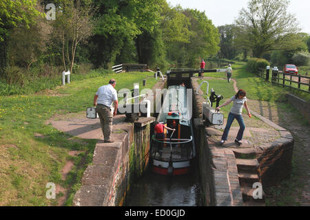 A narrowboat entering Shutt Hill Lock near Acton Trussell on the Staffordshire and Worcestershire Canal - Stock Photo