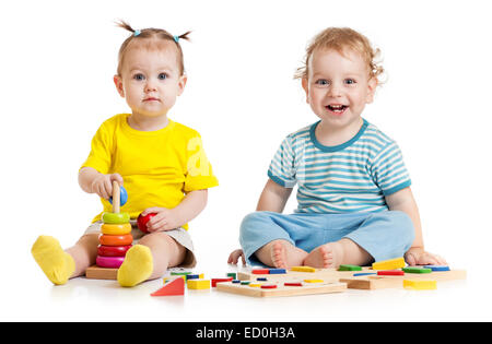 Funny kids playing educational toys isolated - Stock Photo