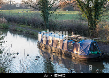 Traditional narrow boat on the Macclesfield canal.  Used by one of growing live-aboard community. - Stock Photo