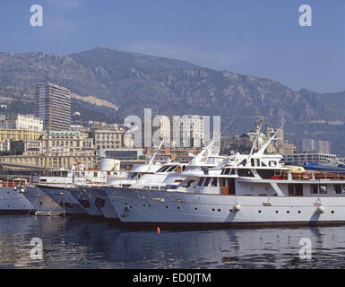 Luxury yachts in harbour, Monte Carlo, Principality of Monaco - Stock Photo